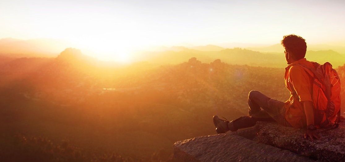 Man siting on a Cliffside